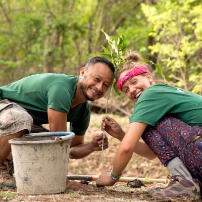 A volunteer and staff member work together on a reforestation initiative during Conservation volunteering in Costa Rica.